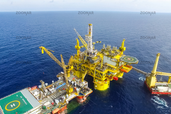 Towing of the oil platform. Drilling platform in the port.