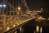 Night view to constraction of the Chain Bridge across river Danube in Budapest.