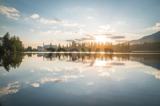 Mountain lake in National Park High Tatras. Strbske pleso, Slovakia, Europe. Late summer evening at lakeside.