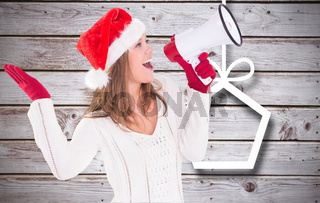 Composite image of festive blonde shouting through megaphone
