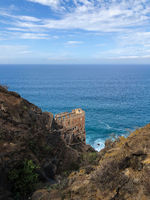 building ruin (Casa del Agua) at coast with ocean background, Tenerife