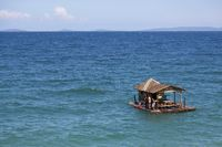 Children jumping from a floating House in the Ocean on Mindoro Island
