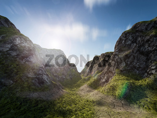 The sun rises over a path through a mountain landscape. Nature, adventure or exploration concept background.