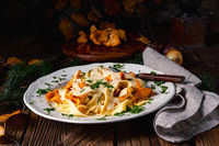 Tagliatelle with fresh chanterelles in a mushroom sauce