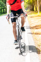 Asian man cycle in countryside road, close up.