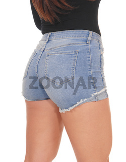 Women butt from back in jeans shorts, close up