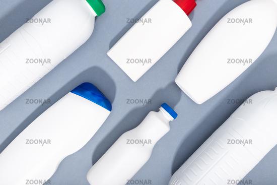Group of white plastic bottles on gray background