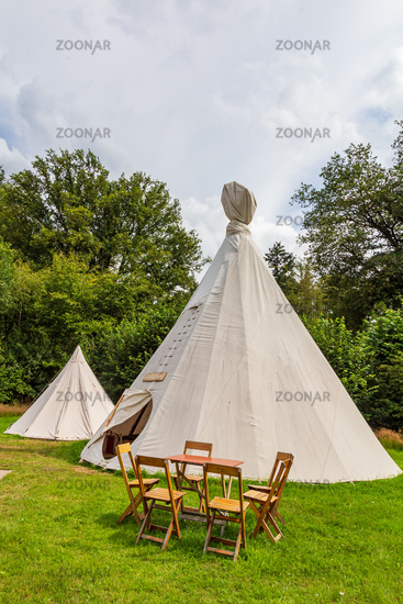 Colorful campsite with wigwam tents