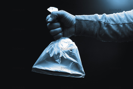 Human hand holding a plastic bag filled with clean air. Coronavirus, ventilation and protection concept.