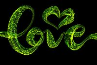 Love word Handwritten lettering written with drawing heart by bright green confetti particles. Isolated on black background