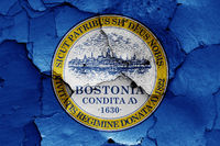 flag of Boston painted on cracked wall