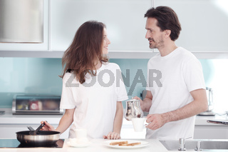 Couple cooking breakfast together