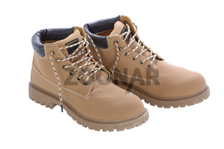 Brown work boots isolated on a white background