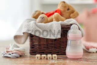 teddy bear toy in basket with baby things on table