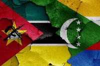 flags of Mozambique and Comoros painted on cracked wall
