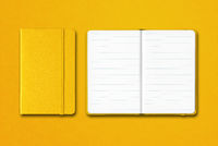 Yellow closed and open lined notebooks isolated on colorful background