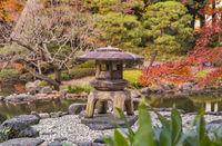 Tokyo Metropolitan Park KyuFurukawa's japanese garden's Yukimi stone lantern overlooking by red mapl