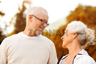 senior couple in city park