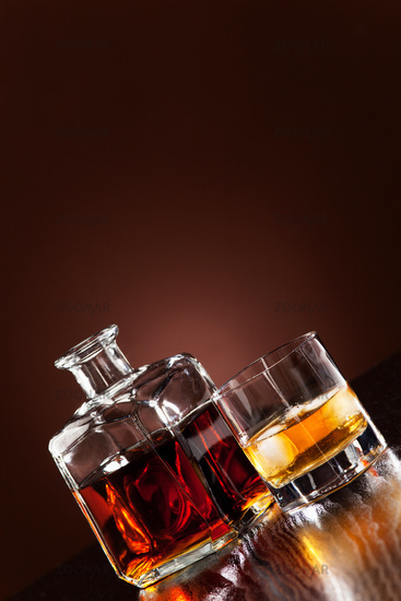 Whisky in glass with ice cubes