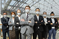 Business people wearing surgical masks