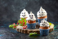 Funny ghost cupcakes. Halloween concept.