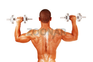 Man working out whit two dumbbells from back