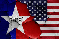 flags of San Antonio and USA painted on cracked wall