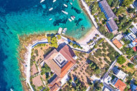 Aerial view of Franciscan monastery and amazing turquoise beach in town of Hvar
