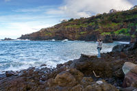 Man photographing the rocky beach in Seixal, Madeira