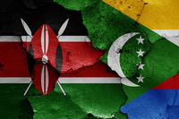 flags of Kenya and Comoros painted on cracked wall