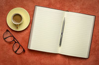 blank notebook or journal with coffee