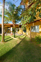 Panama yellow hammocks in the garden of a resort in the tropics