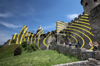 The French town of Carcassonne covered the walls of it's medieval city with circles of yellow for May to September 2018.