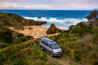 Female on road trip vacation holiday by ocean