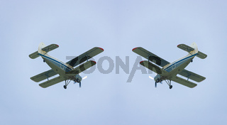 Light-engine propeller aircraft an-2 flying in the sky. View from the ground
