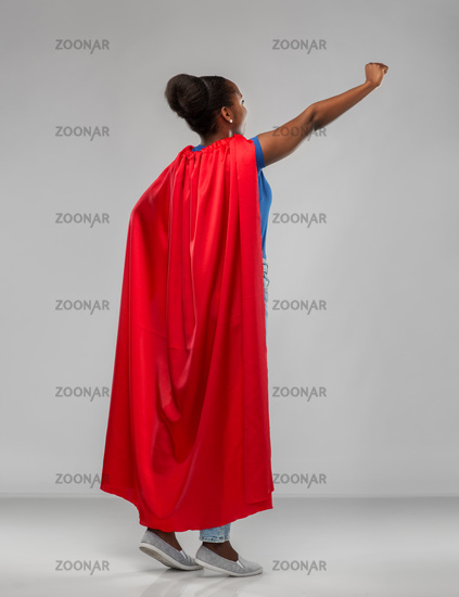 happy african american woman in red superhero cape