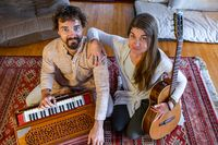 Man woman with harmonium and classical guitar