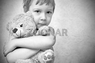 Young boy with teddy bear, portrait