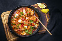 Traditional American fish stew cioppino with prawns