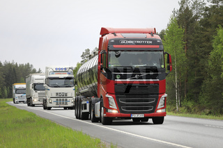 Fleet of Trucks With Red Semi Tanker