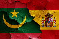 flags of Mauritania and Spain painted on cracked wall