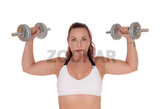 Beautiful woman lifting the two dumbbells up