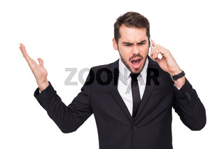 Angry businessman gesturing on the phone