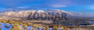 Panoramic view of Mount Timpanogos and residences blanketed with snow in winter