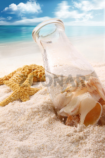 Bottle  with shells on the beach