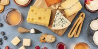 Cheese panorama. Blue cheese, Dutch cheese and others, with wine and bread, shot from the top