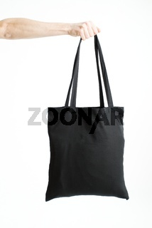 Hand Holding Black Empty Bag