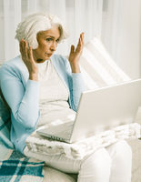 Disappointed White Hear Woman Using Laptop Computer