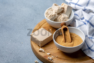 Dry and pressed yeast in ceramic bowls.