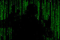 Silhouette of man in green digital data. The symbol of a hacker.